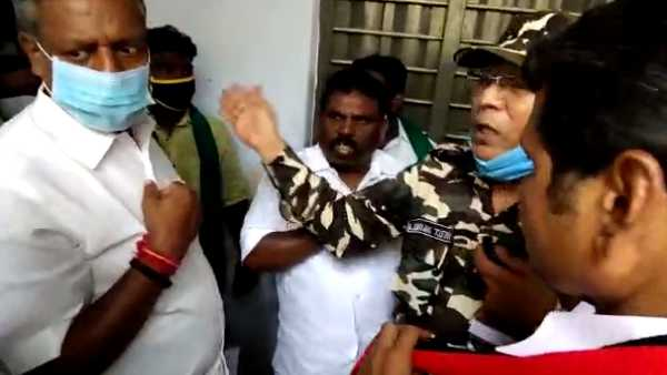 AIADMK man threatening the voters visiting polling stations in Karur