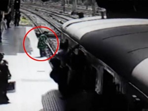Woman Who Leaps Before Train Survives