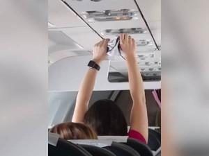 Woman Dries Underwear Under Flight Ac Vent